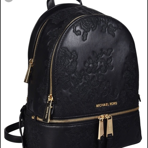 f9cde7ae7ef4 Michael Kors black lace embroidered backpack. M_5b4144ffaa8770131d9f6a90